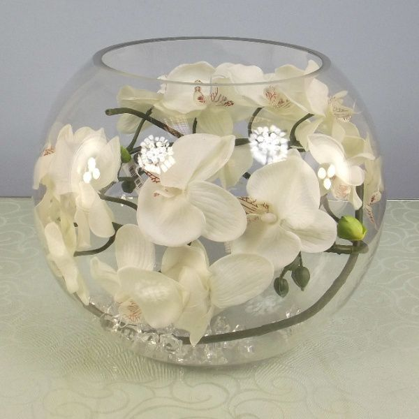 Artificial Silk Moth Orchid In A Clear Glass Fish Bowl