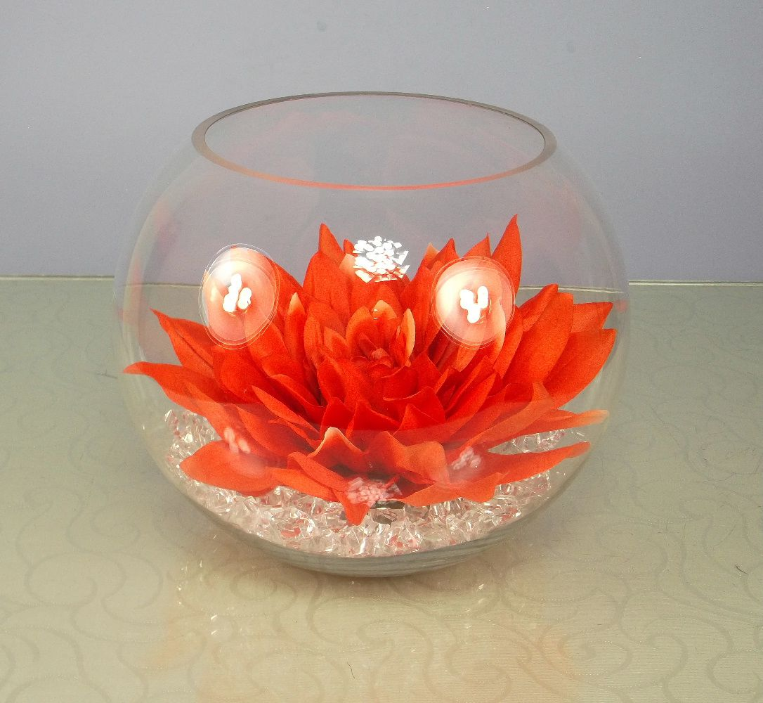 Artificial silk dahlia head in a clear glass fish bowl for Glass fish bowls