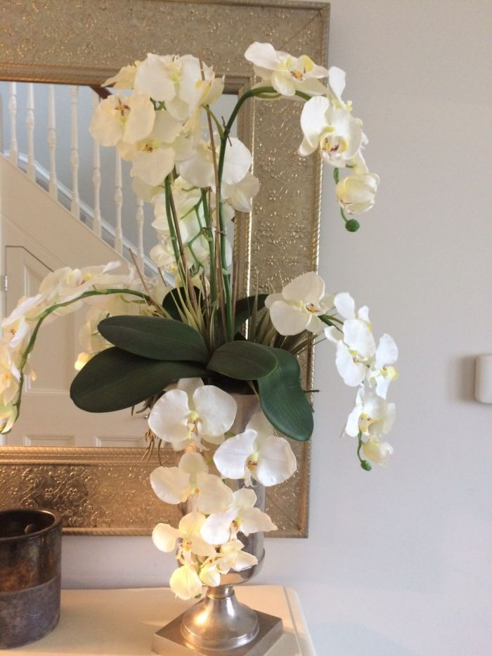 Showing a Bespoke artificial Silk flower arrangement, including the Phalaenopsis leaf, sent in by one of our customers