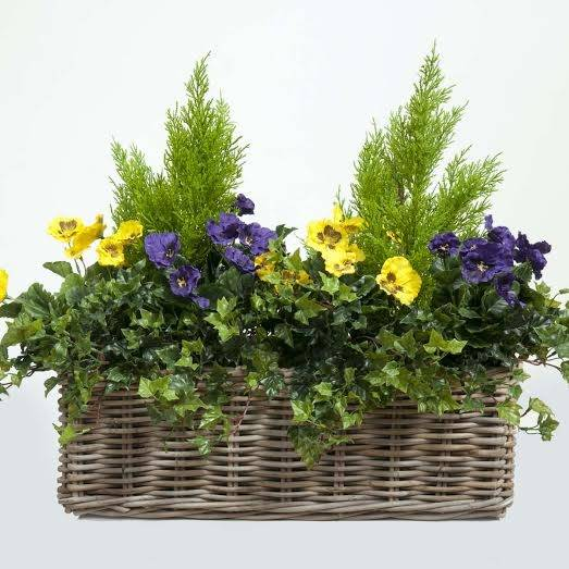 Showing our artificial silk Pansies in a bespoke ready planted trough